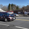 BRYAN EATON/Staff Photo. The hearse carrying former West Newbury deputy fire chief Glenn Coffin passes through the West Newbury Food Mart where he would hold court when the opened every morning.