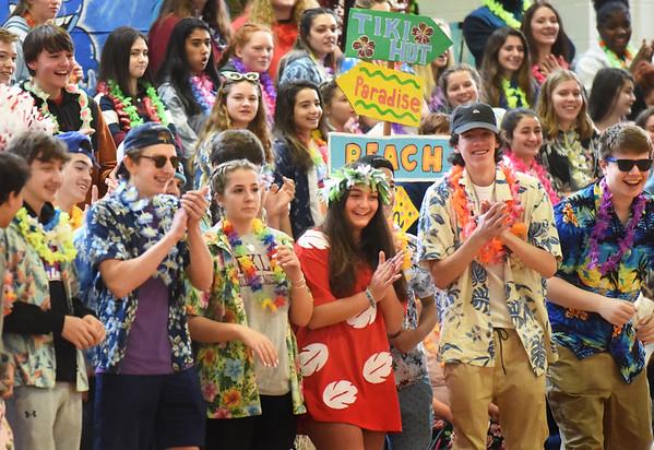 BRYAN EATON/Staff Photo. Amesbury High School sophomores cheer on their classmates in a football relay.
