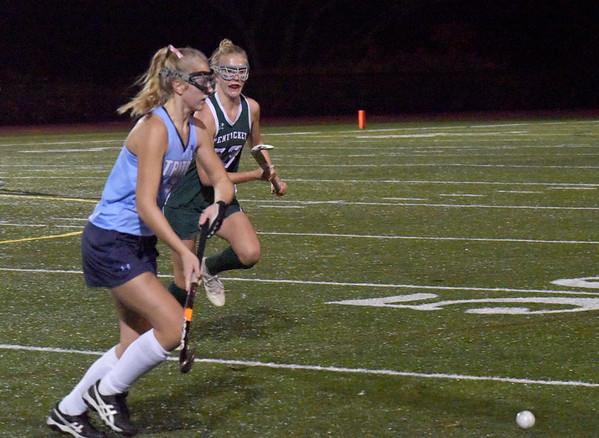 BRYAN EATON/Staff photo. Triton's Brianna Hood and Ally Ward chase a loose ball.