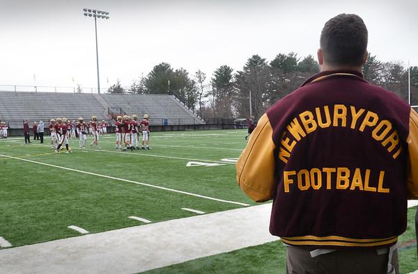 BRYAN EATON/Staff Photo. Newburyport football alumni watch this years' team at practice.