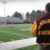 BRYAN EATON/Staff Photo. Newburyport football alumni watch this years' team at practice.