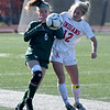 JIM VAIKNORAS/photo Amesbury's Chelsea Lynch fighs for the ball with Mancester-Essex player Emily Beck during their game at Manning Field in Lynn Sunday. Amesbury won the game 2-1 in double overtime.
