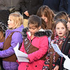 "BRYAN EATON/Staff photo. Brownies from Troop 72433 sing ""God Bless America"" at Salisbury's Veteran Day services."