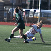 JIM VAIKNORAS/photo Amesbury's Chelsea Lynch collides with Mancester-Essex player Brigid Edgerton during their game at Manning Field in Lynn Sunday. Amesbury won the game 2-1 in double overtime.