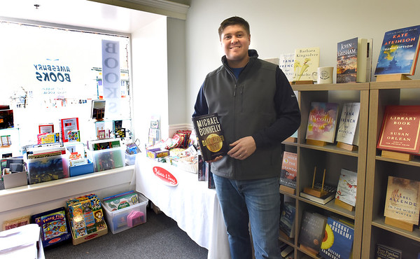 BRYAN EATON/Staff photo. John Hugo has opened a pop-up shop Amesbury Books at 41 Main Street in Amesbury's downtown.