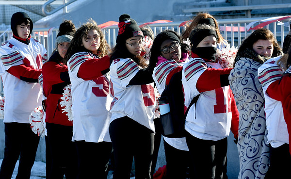 JIM VAIKNORAS/photo  Amesbury cheerleaders bundles up for the game Thursday against Newburyport at Landry Stadium in Amesbury. The Indians won the game 8-0.
