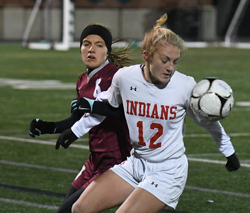 JIM VAIKNORAS/photo Amesbury's Chelsea Lynch fights for the ball  with Millis player Bethany Steiner during their state semi-final game at Mansfield High School Wednesday. Amesbury lost the game 2-1.