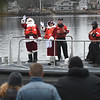 JIM VAIKNORAS/photo Santa and Mrs. Claus arrive on the Newburyport Waterfront courtesy of the US Coast Guard Sunday afternoon for the city's annual parade and tree lighting.