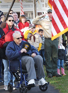 """BRYAN EATON/Staff photo. Attendees to the Salisbury Veterans Day service and memorial dedication listen to Nancy Sweeney sing """"The National Anthem."""""""