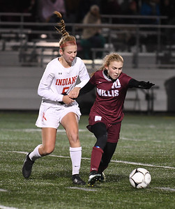 JIM VAIKNORAS/photo Amesbury's Beverly Browns gets tangled with Millis player Erin Mundy during their state semi-final game at Mansfield High School Wednesday. Amesbury lost the game 2-1.