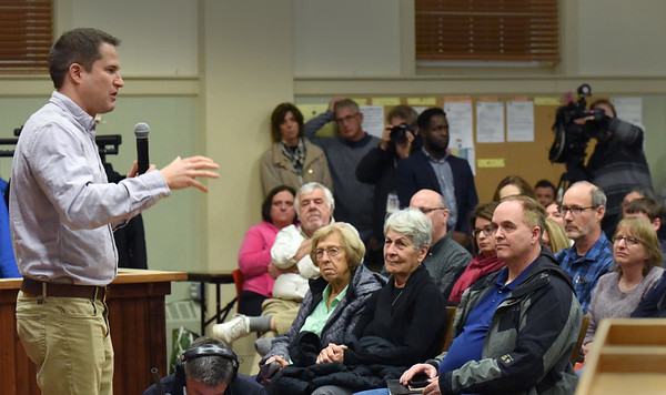 BRYAN EATON/Staff photo. Congressman Seth Moulton spoke at a town hall meeting Monday night in Amesbury, often time defending his call for new leadership over Nancy Pelosi.