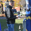 JIM VAIKNORAS/photo Navy veteran Christopher Sullivan prepare to ring one of the service bells the annual Newburyport Veterans Day ceremony City Hall  Monday morning. As the names of local veterans who passed away during the previous year are read a bell is rung honoring their service.