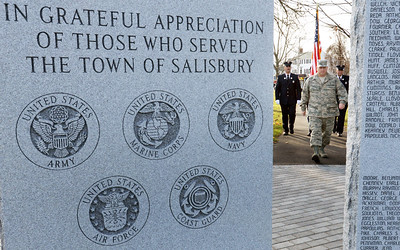 BRYAN EATON/Staff photo. The Color Guard is framed by tablets of the new Vetarans Memorial on Salisbury Common.