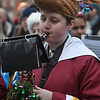 JIM VAIKNORAS/photo Elizabeth Gornam got into the holiday spirit as she performs with the Newburyport and Triton marching Band Sunday afternoon in Market Square at the Newburyport's annual parade and tree lighting.