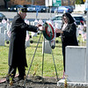 JIM VAIKNORAS/photo Veterans Agent Kevin Hunt and Mayor Donna Holaday lay a wreath at the newly landscapes Veterans Cemetery in Newburyport at the annual Veterans Day ceremony  Monday morning.