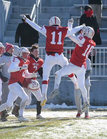 JIM VAIKNORAS/photo Amesbury's #2,Troy Hamel, #7, Logan Burrill, #11 Kyle Donavan, and #18 Patrick Birmingham celebrate their 8-0 victory over Newburyport Thursday at Landry Stadium in Amesbury.