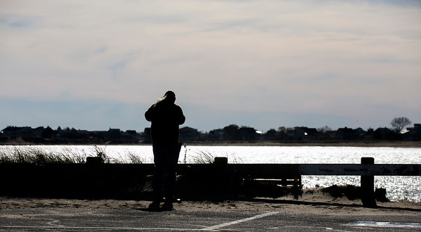 JIM VAIKNORAS/Staff photo Dave Allen of Manchester checks out the early morning light on Salisbury Beach Reservation Thursday.