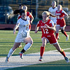 JIM VAIKNORAS/photo Amesbury's  Chelsea Lynch fights for the ball with St.Mary's Riley Lynch at Manning Field in Lynn. Amesbury won the game 1-0.