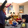 "BRYAN EATON/Staff photo. Lisa Hutchings from Audubon's  Joppa Flats Education Center brought the program ""Penguins To Go"" to the Newburyport Montessori School on Tuesday morning. Here she shows how an orca whale hunting for a meal looks up but can't sea the penguin as its white underbelly blends in with the top of the ocean, represented by a white sheet."