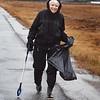 BRYAN EATON/Staff photo. Every Tuesday, even in the rain, Carol Baum walks a two mile loop from her home on Hay Street in Newbury to Newman Road picking up litter. She deposits it into a trash tower in front of Newbury Elementary School to show how much there is.