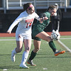 JIM VAIKNORAS/photo Amesbury's Ashlee Porcano fighs for the ball with Mancester-Essex player Madison Lawler during their game at Manning Field in Lynn Sunday. Amesbury won the game 2-1 in double overtime.