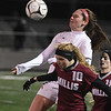 JIM VAIKNORAS/photo Amesbury's McKenna Hallinan goes up for a header with Millis player Erin Mundy during their state semi-final game at Mansfield High School Wednesday. Amesbury lost the game 2-1.