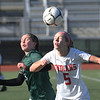 JIM VAIKNORAS/photo Amesbury's Alison Pettet heads the ball with Mancester-Essex player Madison Lawler during their game at Manning Field in Lynn Sunday. Amesbury won the game 2-1 in double overtime.