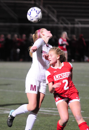 JIM VAIKNORAS/Staff photo Amesbury's Madelyn Creps heads a ball against Millis Tuesday night at Manning Field in Lynn.