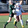 JIM VAIKNORAS/photo Amesbury's Maghan McElaney collides with Mancester-Essex player Maya Baker during their game at Manning Field in Lynn Sunday. Amesbury won the game 2-1 in double overtime.