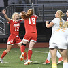JIM VAIKNORAS/photo Amesbury's Gracie Doherty,#18, and Chelsea Lynch, #12 celebrate Doherty's against St Mary's Thursday at Manning Field. Amesbury won the game 1-0.