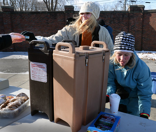 BRYAN EATON/Staff photo. Pentucket High football moms Trisha Etter, left, and Kristin Dole were busy serving coffee and hot choocolate to fans.
