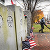 BRYAN EATON/Staff photo. R. J. O'Leary and others from the Newburyport Parks Department spruce up Brown Square for Veteran's Day services that will take place there across from city hall on Monday.