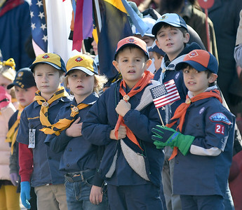 """JIM VAIKNORAS/photo Members of Cub Scout pack 21 look on as the Newburyport High School band plays """"Armed Forces Salute"""" at the annual Veterans Day Ceremony at City Hall Monday."""