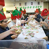 "BRYAN EATON/Staff photo. Wearing elf hats, Immaculate Conception School students wrap cookies in decorative packaging for Saturday's IC North Pole Express. Attendees will leave on the commuter train and head to the ""North Pole"" at the Beverly Depot to return all the while singing songs, eating the cookies and enjoying hot chocolate."