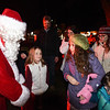 BRYAN EATON/Staff photo. Santa Claus arrived on a Salisbury Fire Department fire engine handing out candy to the children before the lighting of the Christmas Tree at Salisbury Common on Sunday night. After the lighting, which was sponsored by the Salisbury Chamber of Commerce and the Salisbury Historical Society with refreshments provided by the East Parish United Methodist Church and the Institution For Savings. Tours of the Historical Society building, where the East Parish parsonage used to be, were given before the event with refreshments being served there afterwards.