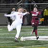JIM VAIKNORAS/photo Amesbury's sara Johnson clears the ball past Millis player Abby Miller during their state semi-final game at Mansfield High School Wednesday. Amesbury lost the game 2-1.