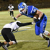 BRYAN EATON/Staff photo. Georgetown's Hunter Lane muscles his way past a Shawsheen Tech defender.