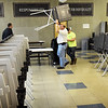 BRYAN EATON/Staff photo. The Amesbury DPW crew helps set up voting booths at Amesbury High School on Monday afternoon.