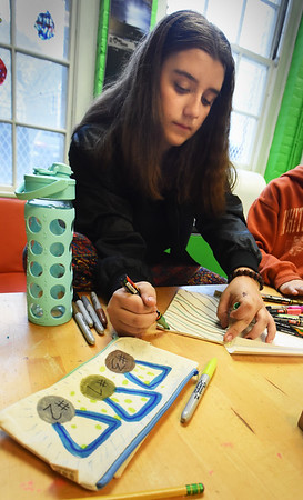 BRYAN EATON/Staff photo. Kate Pomeroy, 14, creates designs with colored Sharpies on pouches in the art room of the Newburyport Rec Center on Monday afternoon. The pouches can be used for storing school supplies as pencils and pens as well as snacks.