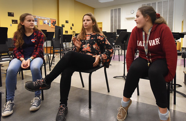 """BRYAN EATON/Staff photo. Three students at the Nock Middle School, from left, Sophia Hartford, Ella Lane and Maddie Marshall, decided to produce and cast a performance of """"Anne of Green Gables."""" One of the adult directors in the fall left the school, so these three girls decided to take on the play and make it happen anyway."""