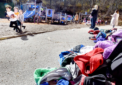 BRYAN EATON/Staff photo. Coats are thrown to the side as children play games at recess at Amesbury Elementary School on Wednesday as the temperature go to 60 degrees. Thursday will be a little cooler, but still with lots of sunshine.