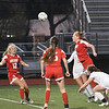 JIM VAIKNORAS/photo Amesbury's Gracie Doherty scores on a header against St Mary's as teammate Chelsea Lynch looks on. Amesbury won the game 1-0.