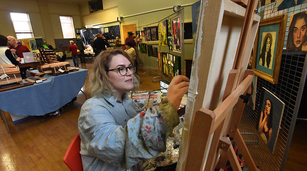 BRYAN EATON/Staff photo. Artist Abby McAllister of Amesbury, who works in oils and portraits, paints in Amesbury Town Hall auditorium during the weekend's Open Studio Tour. Observers said that despite the rough start with the weather, the turnout was very good.