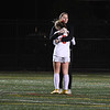 JIM VAIKNORAS/photo Amesbury Keeper Allison Napoli consoles teammate Meghan McElaney after the Indian's 2-1 loss in the state semi-final game to Millis at Mansfield High School Wednesday.