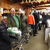 BRYAN EATON/Staff photo. Only a portion of the line at Tendercrop Farm in Newbury is shown in this photo as people waited to get their Thanksgiving Day turkeys on Wednesday which are raised locally by the Newbury farm.