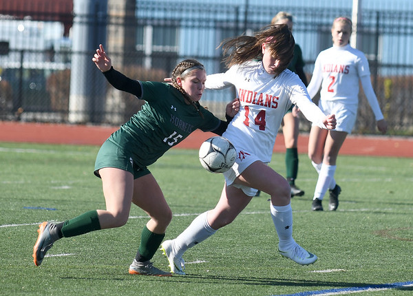JIM VAIKNORAS/photo Amesbury's Ashlee Porcaro fighs for the ball with Mancester-Essex player Madison Lawler during their game at Manning Field in Lynn Sunday. Amesbury won the game 2-1 in double overtime.