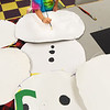 "BRYAN EATON/Staff photo. Riley Tarmey, 10, works on sprucing up Snowmen cutouts in the art class at the Boys and Girls Club in Salisbury on Monday afternoon. The props will be used for the club's dance recital ""December Rockin' Holiday"" on December 7."