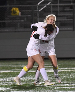 JIM VAIKNORAS/photo Amesbury's Chelsea Lynch hugs teammate Emma DiPietro after the Indian's 2-1 loss in the state semi-final game to Millis at Mansfield High School Wednesday.