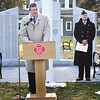 BRYAN EATON/Staff photo. Salisbury Town Manager Neil Harrington speaks at the dedication of the new Veterans Memorial behind him, as Veteran's Agent Kevin Hunt, and selectmen chair Ronalee Ray-Parrot listen.