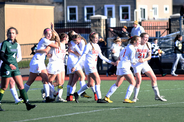 JIM VAIKNORAS/photo Amesbury High soccer team celebrate their North Sectional Championship at Manning Field in Lynn Sunday. Amesbury defeated Manchester-Essex  2-1 in double overtime.